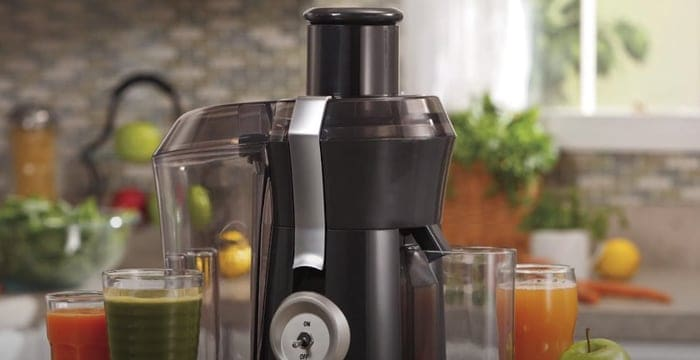 making juice with a juicer