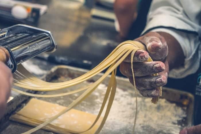 person making tagliatelle
