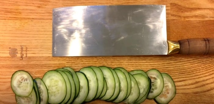 Knife and cucumber