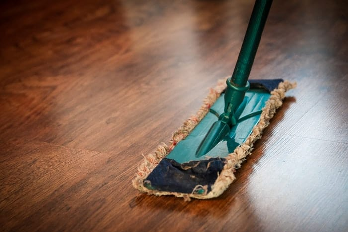cleaning a brown wood