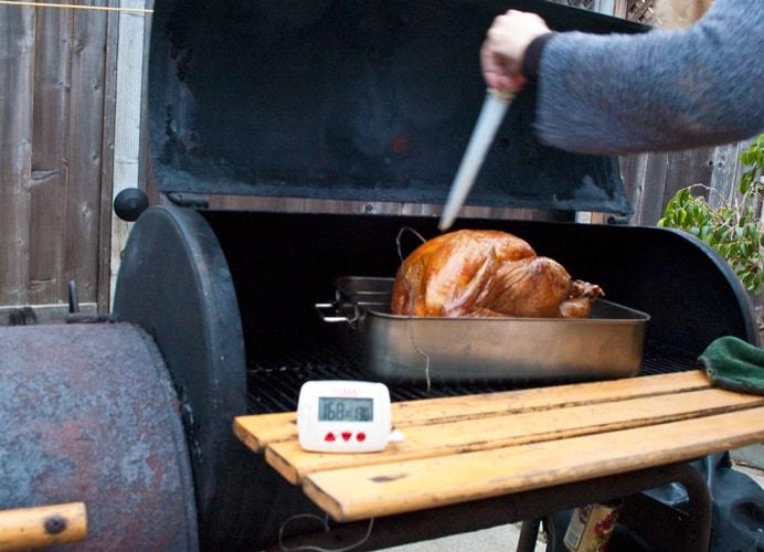 cooking chicken in a vertical smoker