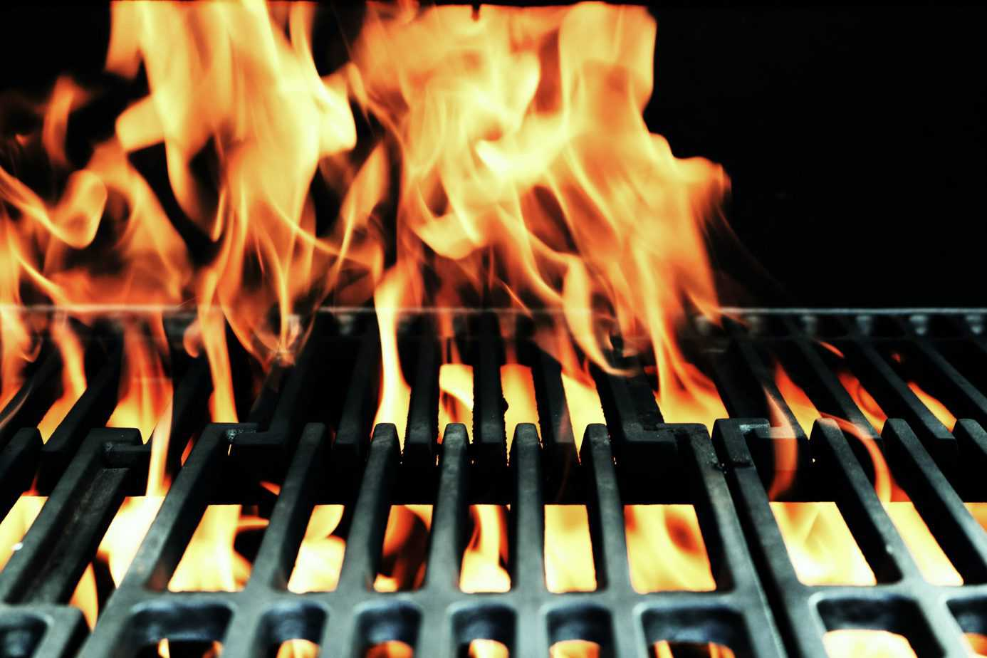 pouring lighter fluid on a grill