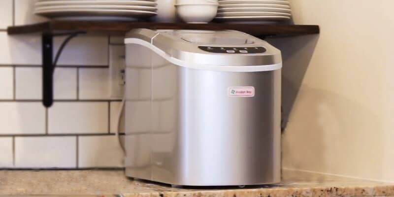 Portable ice maker on the kitchen counter