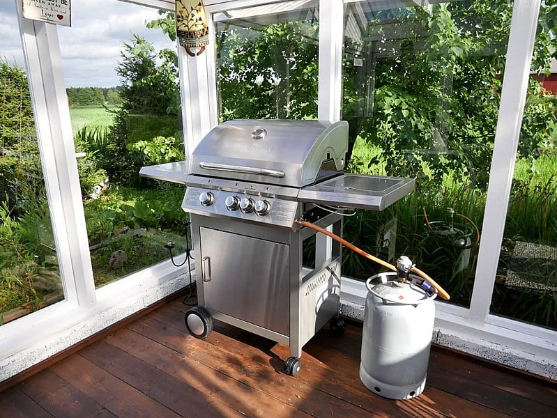 gas grill on wood deck